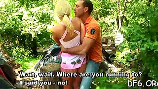 A blonde floozy gets scored in the woods by a handsome stud with a huge pecker