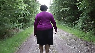 my wife walking near-naked in the woods