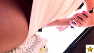 Stunning brunette babe with fabulous legs voyeur upskirt
