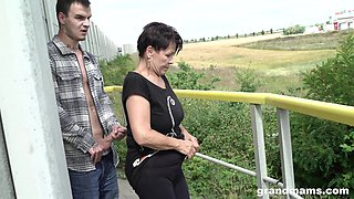 Short haired mature granny gives a sloppy blowjob POV outdoors