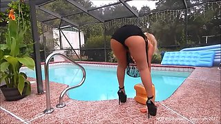Cleaning the pool in daisy dukes