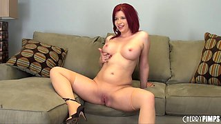 Torrid cam show where a curvy redhead fucks her wet pussy
