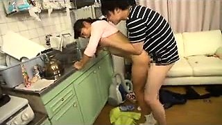Busty Japanese housewife enjoys wild sex with a young man