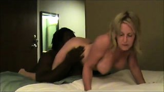 Stacked blonde mature relishes a wild interracial threesome