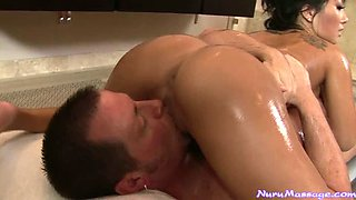 Oiled up Asian lady Asa Akira performs steamy fellatio to white stud in 69 pose