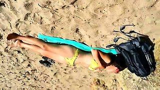 Beach voyeur jerks his cock while a sexy babe enjoys the sun