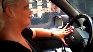 Gina drives car with great Long Nails