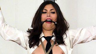 Slender brunette milf in stockings gets trained in bondage