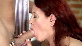 Redhead mature gets banged by young hung stud