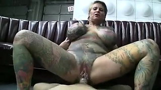 Totally tatoed and pierced milf (Camaster)