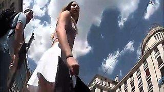 Street voyeur captures a striking blonde with a splendid ass