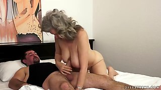 busty mature granny sucks and fucks on a bed