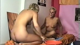 Two sexy and playful blonde friends shaving pussies