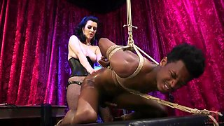 bound black man getting his ass fucked by brunette mistress