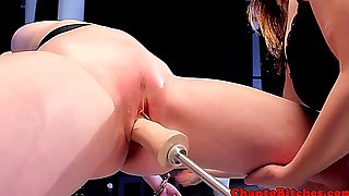 Lezdom dom using sex machine with kinky submissive
