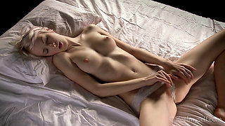 Beautiful blonde masturbates herself in bed