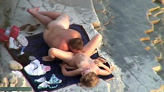 chubby man and his gf on the beach