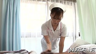 Oriental nurse deals extra big penis betwixt the lips
