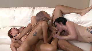 Three women are with a man that has a large cock in a foursome
