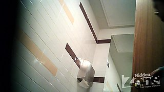 Blonde girl pissing in toilet on the hidden camera