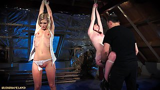 Punishing two teen slaves using leather whip
