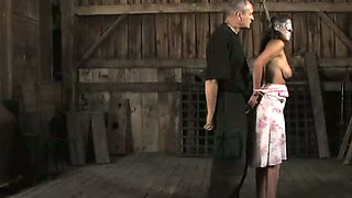 Busty babe is tied up in the dungeon