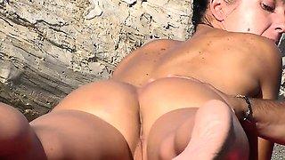Sexy naked people in a beach spy voyeur video