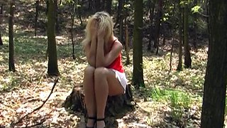 Hot blond in short skirt with nice natural tits helps stud get off in woods