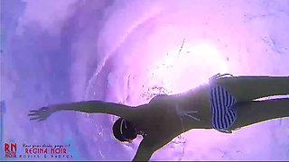 Amazing underwater bikini show. Elegant flexible babe swims