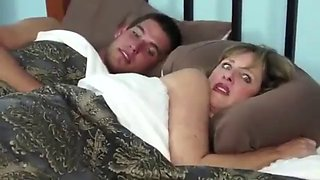 Mom son share hotel bed