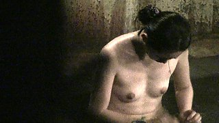 Petite Japanese girl reveals her tiny tits in the bath house