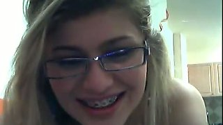 Slender nerdy teen in glasses with brackets gives me private webcam show