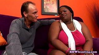 Big black woman shows massive tits and gets laid