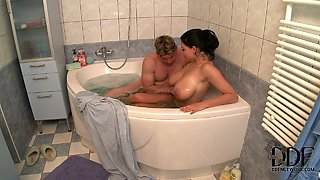 Amazing brunette cutie with huge tits feeds a blonde stud