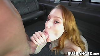 Young redhead persuaded to get fucked in the fuck bus