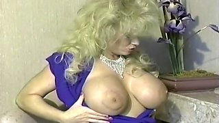 Curvy and hot lascivious white lady with big tits shows off topless