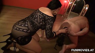 Thick mistress Irina fucks her slave's ass with a dildo before sucking his dick
