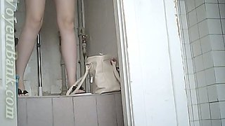 Pale skin amateur white lady in black dress pisses in the toilet