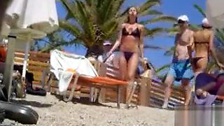 Tanned blonde takes off her bikini after a swim