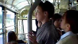 Girls grope mature milf in kimono in the bus