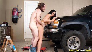 Black-haired nympho Skyla Novea getting fucked in a garage