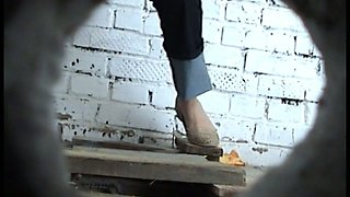 White girl in dark blue jeans filmed pissing in the toilet room