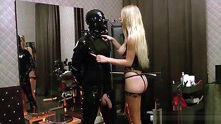 Latex Blonde Mistress kicks hanging balls