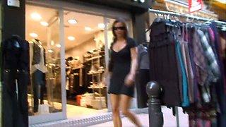 BDSM model Alex Zothberg in mini dress showing sporty legs
