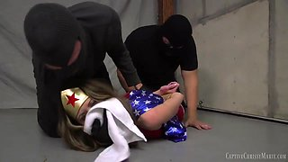 Superheroine Wonder Woman Captured Chained Up And Forced To
