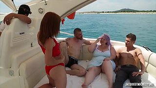 Purple haired plumper with massive tits is using her deep throat to satisfy two horny guys