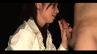Provoking Japanese babe works her skillful hands on a dick