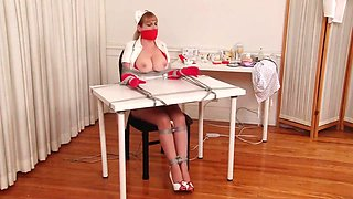 Nurse at table on chair