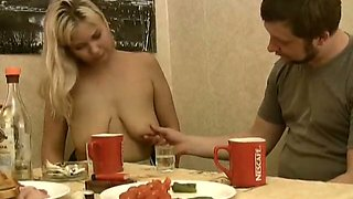 Good looking blonde gets her huge succulent tits fondled by her lover