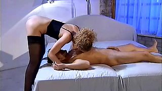 A curly girl in stockings gets fucked in both holes as she likes